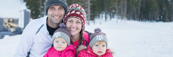 Family of four in the snow