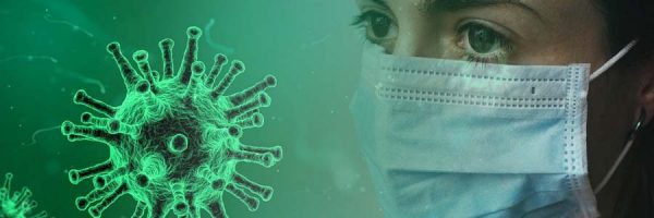 Woman with mask facing a simulation of the COVID-19 virus