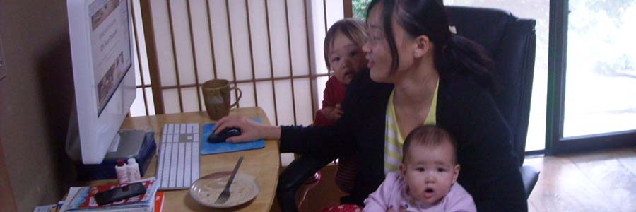 Mom with two kids working on her computer