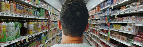 Man facing a grocery aisle