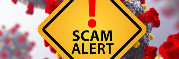 Scam Alert sign with COVID-19 virus background