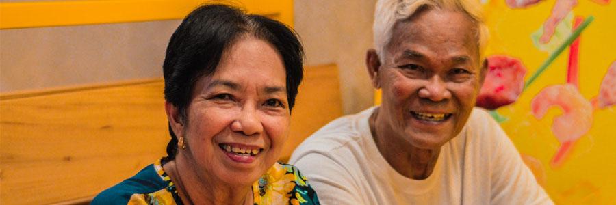 A grandma and grandpa smiling