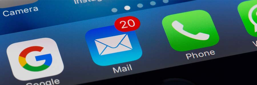 Close-up of email and phone icons on a smartphone