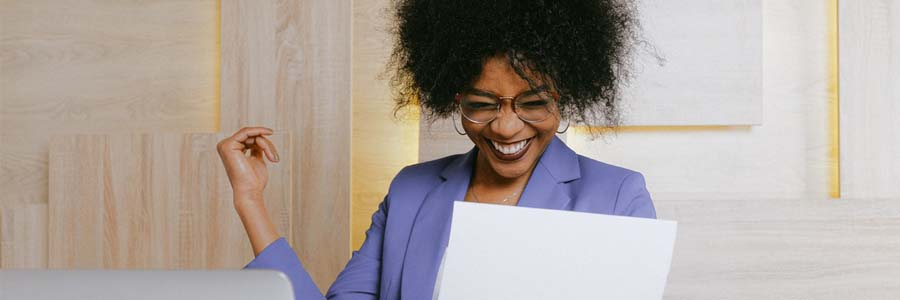 Lady at work smiling excitedly