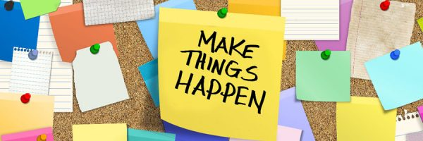 "Cork board with a post it saying ""make things happen"""