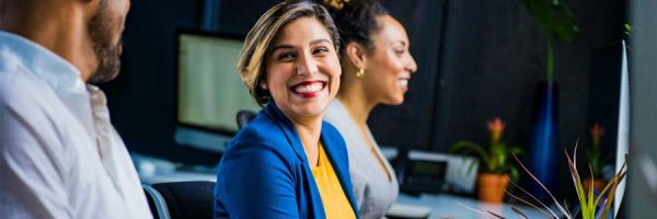 Woman smiling at co-worker