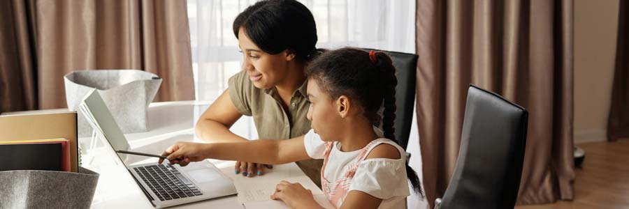 Mom helping child do homework