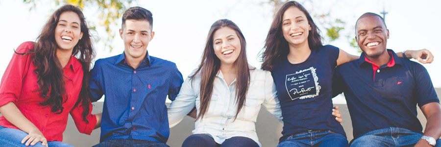 A group of young people smiling