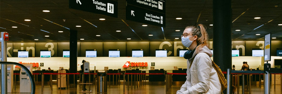 Lady with mask at the airport